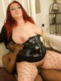 Plump redhead slut Jemstone in black corset and boots gets hardcored by black dude