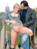 Euro blonde Angie in boots and dress gets her hairless pussy poked in public place
