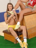 Young naughty lesbians Cindy and her friend sniffing shoes and licking toes after gym class