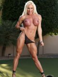 Blonde female bodybuilder Ashlee Chambers shows off her swollen purple melons