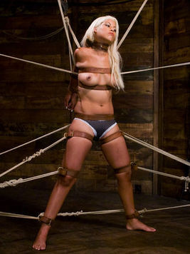 Long haired blonde latina Bridgette B gets bound with ropes and straps by Damon Pierce