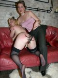 Bare assed blonde Susi M in black stockings gets spanked and tortured by Lady K