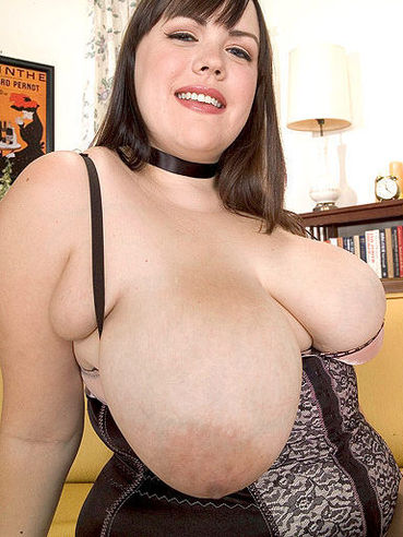 Long haired chunky brunette Isabell Lane in black lingerie shows her big breasts with enthusiasm