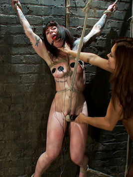 Francesca Le blindfolded and getting punished with bondage toys by nasty babe Vivienne Del Rio.