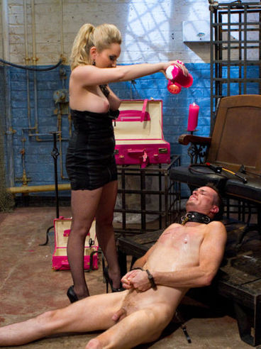 Femdom Aiden Starr smearing a fat cock against her man-slave's face and gets stimulated.