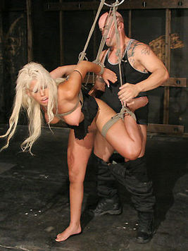 The blonde Bridgette B's body is stretched to limits by the ropes and dick of kinky Derrick Pierce.