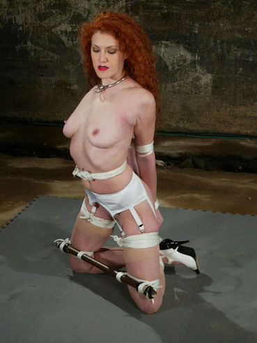 Underwater punishment is new to alluring red-haired slave girl Sabrina Fox