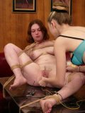 Ginger spreads her legs for domina Chanta Rose and gets her shaved pussy tortured