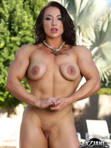 Hot female bodybuilder Brandi Mae Akers shows off her big firm tits and long muscled legs and arms.