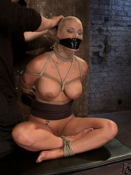 Slutty blonde Phoenix Marie with big melons gets blindfolded and drilled in the tight asshole.