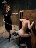 Riley Shy put into stocks and tazzed during a kinky bondage session with Princess Donna Dolore.