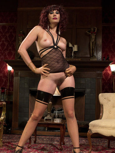 Auburn haired Maitresse Madeline drilling a dude's tight ass-hole and teasing her cock in femdom.