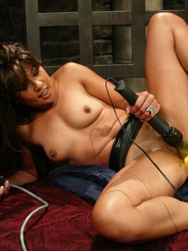 Asian milf Max Mikita is about to orgasm as she gets her pussy drilled to death by dildo machine