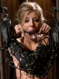 Blonde Chastity Lynn with nice curves is gagged, tied up and restrained with a straitjacket.