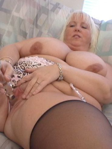 Plump huge titted blonde in lingerie Daphne Stone pleases herself with glass dildo