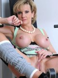 Big boobed mature Lady Sonia spreads her pussy lips and shows her pink hole