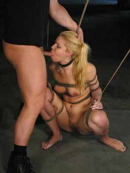 Tied up Hollie Stevens loses her tight jeans and gets her meaty pussy banged in the dungeon