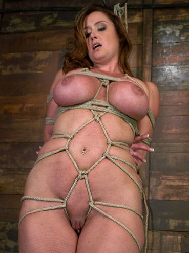 Sexy curvy woman Christina Carter with breathtaking big boobs gets bound