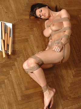 Naked big titted Roxy Taggart tied up with tape gets her pussy dildoed on the floor