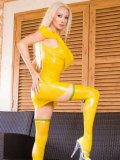 White-haired busty bombshell Saffron Taylor poses in yellow latex dress and stockings