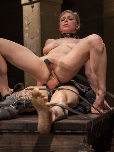 During the bondage games, Penny Pax is spreading her legs wide to show off that nasty twat.