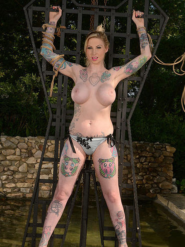 Tattooed princess Hollie Hatton gets strapped up and immersed into water during kinky bondage.