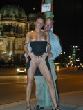 Vicky W exposes her shaved pussy and gives blowjob in the night streets of Berlin