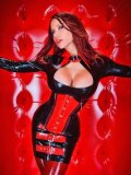 Fetish model in latex Bianca Beauchamp shows off her huge boobs and sexy suit