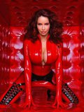 Big racked auburn milf model Bianca Beauchamp loves posing in tight red latex outfit