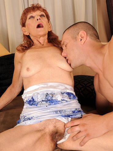 Red-haired granny Irene with hairy snatch gets fucked again by younger dude