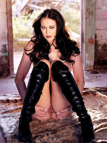 Brunette Alexis Grace takes off her black body and poses naked in high boots
