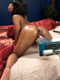 Busty ebony hottie Chanell Heart gets her dark wet shaved pussy drilled deep with a sex machine