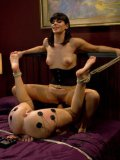 Roxanne Hall tied to the table and getting her bondage body teased and tazed by kinky Bobbi Starr.