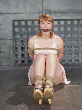 Mature red-head Claire Robbins tied with ropes and filled up with toys during BDSM.