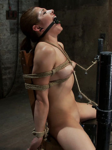 Dark haired girl Evilyn Fierce gets tied to chair before nipple torture