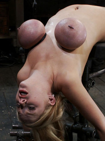 Slave Katie Kox with tied enormous tits shows her flexibility in crab position.