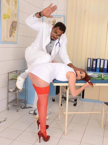 Leila Moon wearing a sexy nurse uniform and getting stretched open with a black doctor cock.