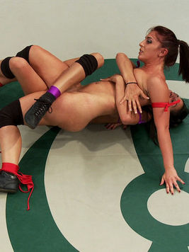 Mischa Brooks has sexy Lyla Storm in a tight lock on the floor while wresting in cat fights.