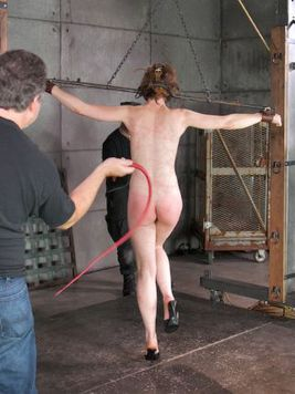 Hazel Roze gets wrapped up in ropes and has to endure kinky bondage and rough spanking.