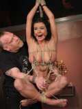 Sexy bodied big boobed brunette Bailey Brooks gets her pussy vibrated in rope bondage