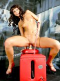 Slender Jezzy Jane with tiny tits and tight bald pussy rides dildo machine standing up
