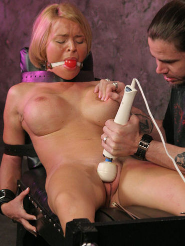 Perfect titted bondage blonde Krissy Lynn tries to squeeze her legs as master vibes her bald snatch