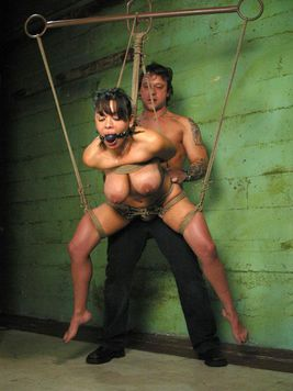 Hot latina slave Sienna West with DD tits gets her mouth and pussy fucked silly by rope master