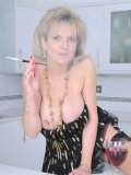 Good looking MILF Lady Sonia enjoys smoking while playing with her melons.
