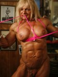 Bodybuilder Maryse Manios with amazing hard muscles makes no secret of her big tits and bald pussy