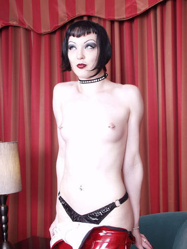 Stocking goth brunette Genesis LaVey with pierced nipps takes off her red dress and black panties
