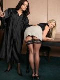 Blonde Carolyn Reese in black stockings and pink panties gets spanked by brunette judge