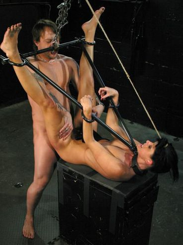 Dark haired slave mom India Summer gets her pussy tortured and fucked in the dark of the dungeon