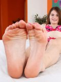 Revealing her feet and legs is what Alice March does best and it makes her horny.