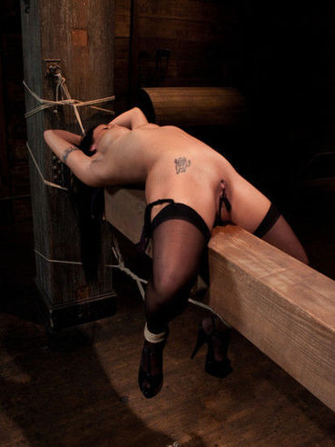 Plump brunette Mahina Zaltana gets her shaved soft pink pussy lips and booty pulled with ropes.